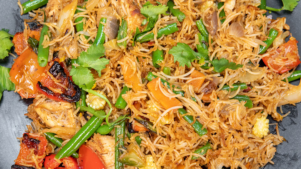 This is an image of a stir-fry chicken meal.